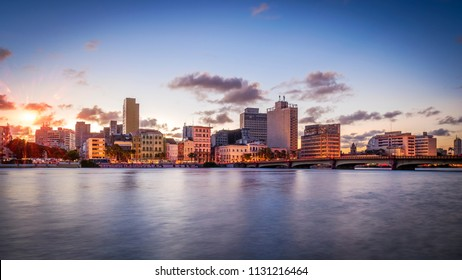 RECIFE, BRAZIL - MARCH 22, 2018: The historic architecture of Recife in the state of Pernambuco, Brazil at sunset by the Capibaribe river.