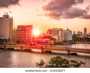 RECIFE, BRAZIL: MARCH 23, 2018: The architecture of Recife in the state of Pernambuco, Brazil with its mix of contemporary and historic buildings by the Capibaribe river at sunset.