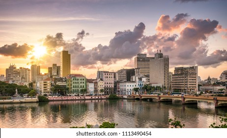 RECIFE, BRAZIL - MARCH 23, 2018: The historic architecture of Recife in Pernambuco, Brazil with its mix of contemporary and colonial buildings at sunset by the Capibaribe River.