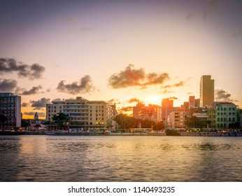 RECIFE, BRAZIL - MARCH 23, 2018: The skyline of the historic city of Recife in the state of Pernambuco, Brazil by the Capibaribe river at sunset.