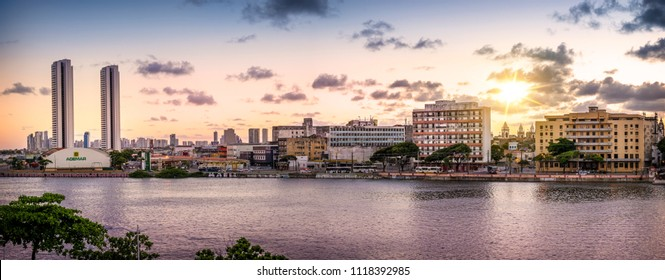 RECIFE, BRAZIL - MARCH 24, 2018: The historic architecture of Recife in Pernambuco, Brazil at sunset by the Capibaribe River.