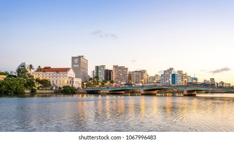 RECIFE, BRAZIL - MARCH 25, 2018: Panoramic view of the historic city of Recife in Pernambuco, Brazil showcasing its architecture at sunset by the Capibaribe River.