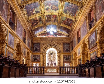 RECIFE, BRAZIL - MARCH 25, 2018: The rich Baroque architecture of Capela Dourada church in Recife, Pernambuco, Brazil with its saint images and sculptured wall covered with pure gold.