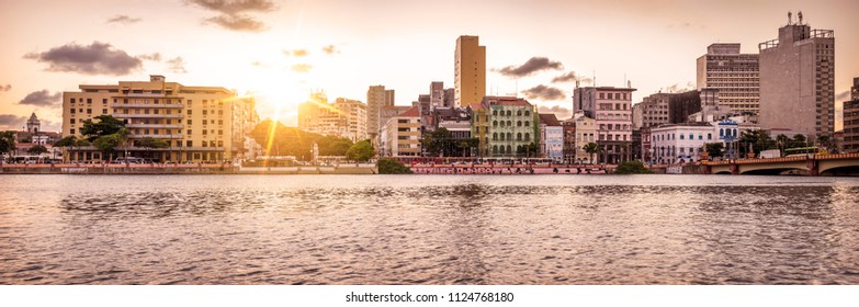 RECIFE, BRAZIL - MARCH 26, 2018: Panoramic view of Recife in Pernambuco, Brazil showcasing its mix of contemporary and colonial architecture at sunset by the Capibaribe river.