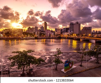 RECIFE, BRAZIL - October 10, 2018: The skyline of Recife in Pernambuco, Brazil at sunset showcasing its historic buildings by the Capibaribe River.