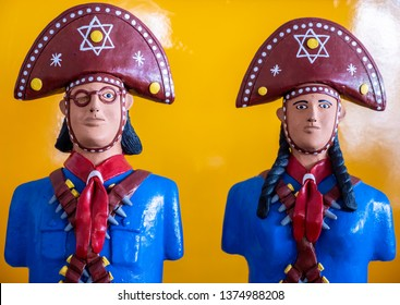 RECIFE, PE, BRAZIL - APRIL15, 2019: Brazilian art and craft from Recife in Pernambuco, Brazil made of clay and painted with vibrant colors representing two famous locals, Lampiao and Maria Bonita.