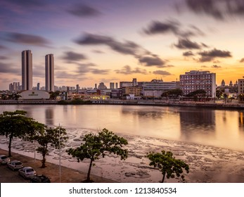 RECIFE, PE, BRAZIL - JUNE 10, 2018: By the Capibaribe river in the state of Pernambuco, Brazil, the skyline of Recife at sunset with its mix of historic and contemporary building.
