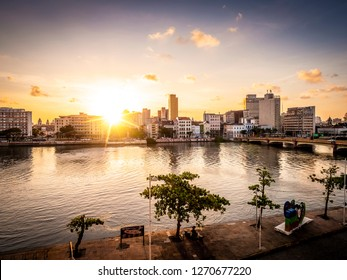 RECIFE, PE, BRAZIL - MARCH 10, 2018: The iconic sunset behind the historic buildings of Recife in Pernambuco, Brazil by the Capibaribe River.