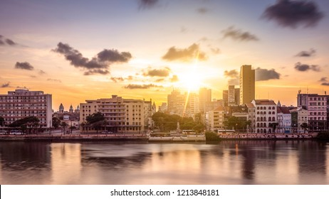 RECIFE, PE, BRAZIL - OCTOBER 10, 2018: The skyline of Recife in Pernambuco, Brazil at night by the Capibaribe river showcasing its mix of colonial buildings and contemporary ones.