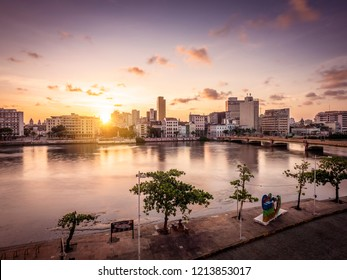 RECIFE, PE, BRAZIL - OCTOBER 10, 2018: The historic architecture of Recife in Pernambuco, Brazil at sunset by the Capibariber river.