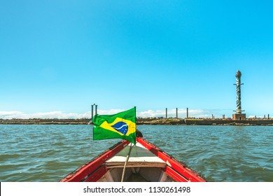 Recife, Pernambuco, Brazil - JUN, 2018: Sculpture Park Francisco Brennand, view from a boat at Capibaribe River with brazilian Flag