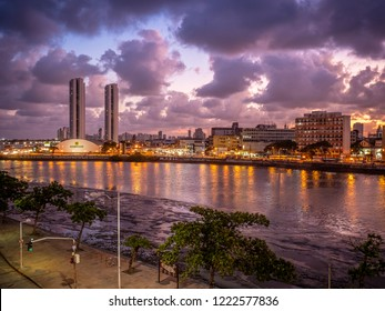 RECIFE, PERNAMBUCO, BRAZIL -OCTOBER 15, 2018: The historic architecture of Recife in Pernambuco, Brazil showcasing its mix of colonial and contemporary buildings by the Capibaribe River at sunset.