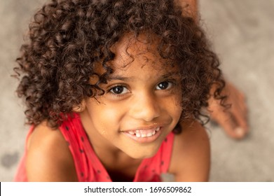 Recife, Pernambuco/Brazil - March 30 2020: beautiful black homeless girl together in line for food donation in the city of Recife during the covid-19 / coronavirus outbreak