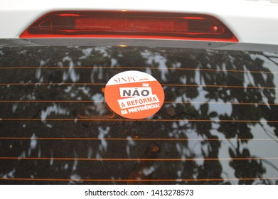 """Recife/Pernambuco/Brazil - May 15 2019: Syndicate tick pasted on the car rear window written """"No to the pension reform"""" against the brazilian government pension reform"""