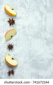 Recipe background with three apple wedges and star anise