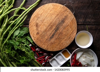 recipe book with fresh herbs south asia and spices on wooden background, thai food
