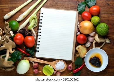 Recipe book fresh herbs south asia imagen de archivo stock recipe book with fresh herbs south asia and spices on wooden background hot and sour forumfinder Gallery