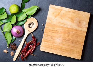 recipe book with fresh herbs south asia and spices on dark background, thai food.