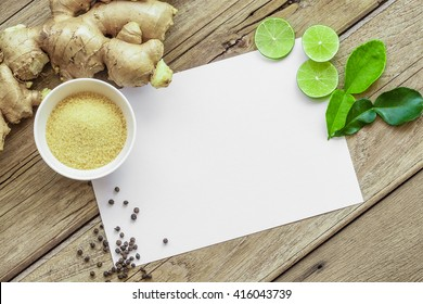 Recipe card on Old Wood Texture Background with cutted lime, pepper, shugar and ginger