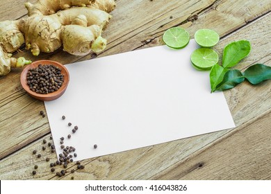 Recipe card on Old Wood Texture Background with cutted lime,lime leaves pepper and ginger