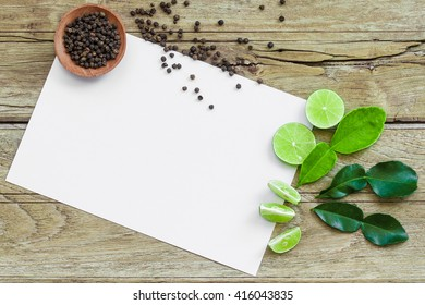 recipe card on Old Wood Texture Background with cutted lime and pepper