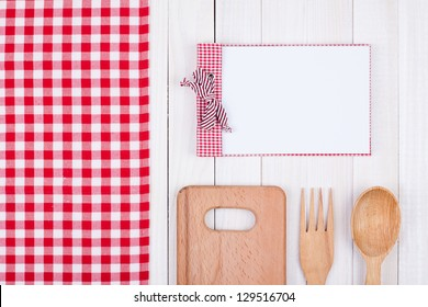 Recipe cook book, kitchen equipment on white wood background