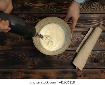 """Recipe of cooking of a dessert of Tiramisu, part fourth: """"Whipping Cream"""". Products on a wooden table: fat cream."""
