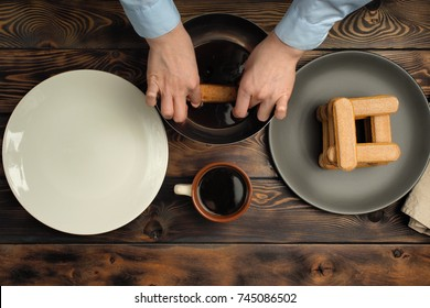 """Recipe of cooking of a dessert of tiramisu, part sixth: """"Biscuit impregnation in coffee"""". Products: Strong coffee and Ladyfinger biscuit."""