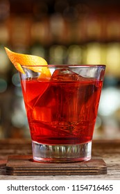 Recipe for cooking Negroni. Classic recipe with gin, campari and martini rosso. Cocktail is on the bar in the restaurant
