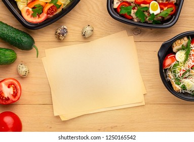 Recipe of healthy lunch. Plastic boxes with ready dishes, fresh vegetables, quail eggs and paper for notices on the wooden table , top view, mockup
