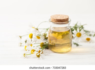 Recipes of traditional medicine with a decoction of chamomile at home. Immunity enhancement in alternative medicine. Recipes of the cosmetics with chamomile. An empty space to insert text.