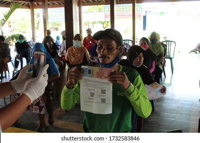 A recipient of social assistance from the government shows the money he received - Madiun, East Java, Indonesia May 13, 2020