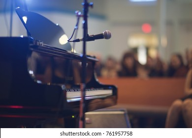 Recital Music Performance large venue with Grand Piano and microphone. Shot from back of stage.