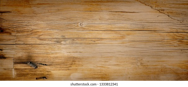Reclaimed vintage wood surface with aged boards. Wooden planks on a wall or floor with grain and texture.