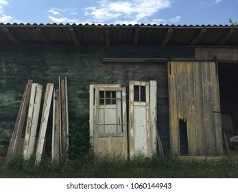 reclaimed wood barn with salvage antique doors