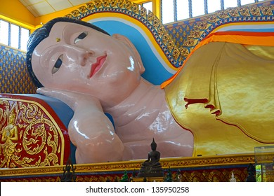 Reclining Buddha At A Buddhist Temple In Penang, Malaysia