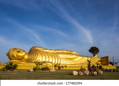 Reclining Buddha gold statue face at Bangkok, Thailand