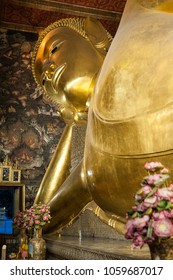 The reclining Buddha at Wat Pho Temple, Bangkok, Thailand. The temple is first on the list of six temples in Thailand classed as the highest grade of the first-class royal temples.