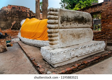 The reclining white Buddha statues or nirvana view from feet located at Wat Yai Chaimongkol, and is famous attractions at Ayutthaya, Thailand.
