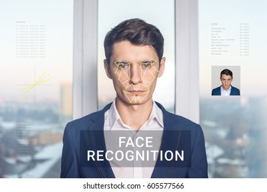 Recognition of a male face by layering a mesh and the calculation of the personal data by the software. Biometric verification and identification