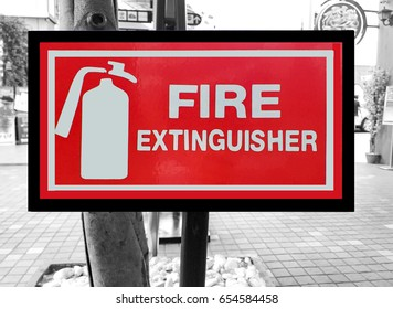 recommend sign,caution,advise,suggest,fire extinguisher sign on street