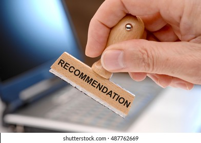 recommendation printed on rubber stamp in hand