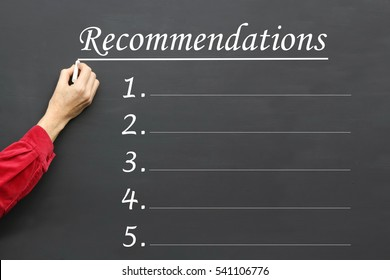 Recommendations business concept with five spaces for ideas written on a blackboard.