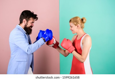 Reconciliation and compromise. knockout punching. who is right. win the fight. bearded man hipster fighting with girl. problems in relationship. sport. Strength and power. family couple boxing gloves.