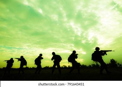 Reconnaissance soldiers on duty under the yellow sky.