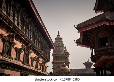 Reconstructed ancient Bhaktapur Durbar Square located in Kathmandu Valley after 2015 earthquake in Nepal: view on hindu temples and 55 Windows Palace as a part of UNESCO World Heritage site