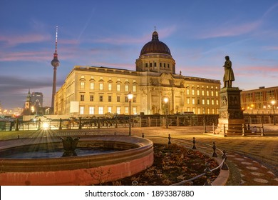 The reconstructed City Palace and the famous Television Tower in Berlin before sunrise - Shutterstock ID 1893387880