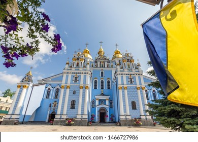 Reconstructed St. Michael's Golden-Domed Monastery with Ukranian flag at Kiev, Ukraine.