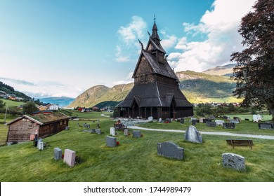 Reconstructed wooden church in Norway with cemetery.