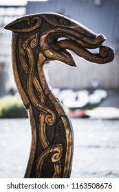 Reconstruction. Hand-cut of traditional wood totem head of a mythical dragon on the gate column or Scandinavian Drakkar. protective mythical symbol of the Scandinavian Vikings.